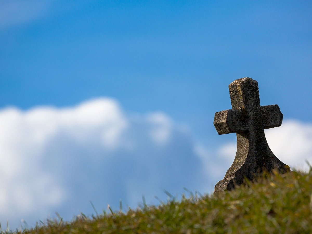 a gravestone on top of a mountain